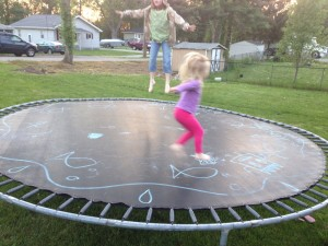 Sidewalk chalk writes well on a trampoline, and stands out against the surface.